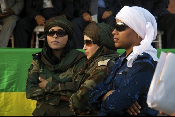 http://www.bodyguardcareers.com/wp-content/uploads/2011/06/gaddafi_bodyguards-10-2011-3-1.jpg